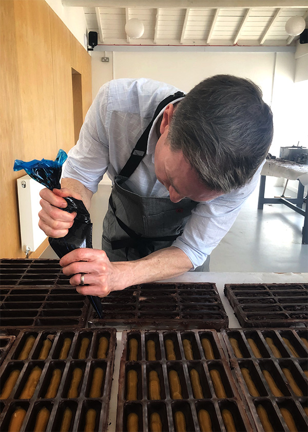 David Crichton filling bars